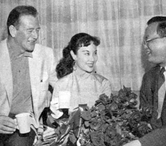 "John Wayne with Li Hua Li, the number 1 boxoffice star in the Far East at the time, with her brother. Wayne's Batjac Productions was preparing Li to star in ""China Doll"" with Victor Mature in '58."