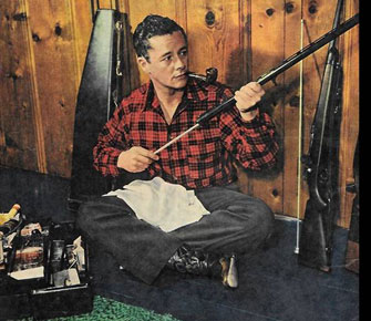 Tim Holt keeps his hunting rifles clean in 1948. (Thanx to Bobby Copeland.)