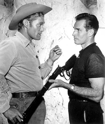 "Chuck Connors talks about ""the rifle"" with Charlton Heston."