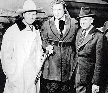 "Gene Autry visits Richard Dix and director George Nicholls Jr. on the set of ""Man of Conquest"" ('39 Republic)."