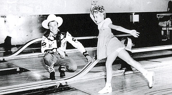 Republic's juvenile star Twinkle Watts bowls a few frames with a little help from Roy Rogers. Circa 1945.