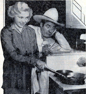 "Toby Wing and Tom Mix stir up a little breakfast aboard the famed ""42nd Street"" General Electric Kitchen Special. The train traversed the U.S. in early 1933. Stars aboard included not only Mix and Wing but Lyle Talbot, Laura LaPlante, Glenda Farrell, Bette Davis, Eleanor Holm, Preston Foster, Leo Carrillo, Lois January and others."