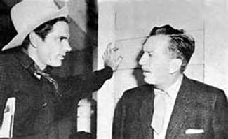 "Disney TV's ""Texas John Slaughter"" (Tom Tryon) talks with 'Uncle' Walt Disney."