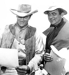 "James Arness and director Andrew McLaglen on the set of ""Gunsmoke""."