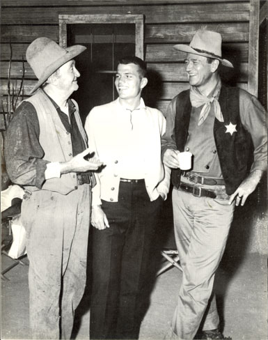 "Walter Brennan, Pat Wayne and John Wayne have a chat during a break from filming ""Rio Bravo"" ('59 Warner Bros.)."