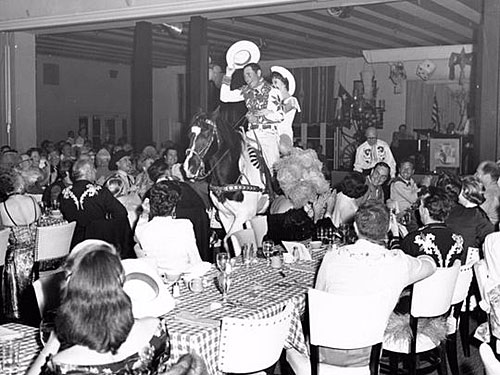 Montie Montana on his horse Rex treats a guest to a ride into the Palm Springs El Mirador dining room in the mid-'50s.
