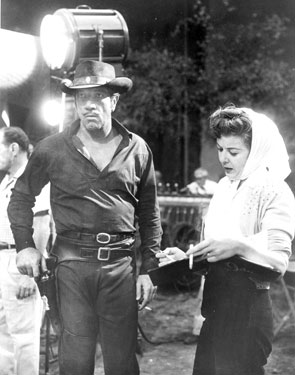 "Richard Boone and director Ida Lupino work on a scene for ""Have Gun Will Travel""."