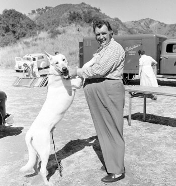 "Andy Devine meets Chinook while Andy was on location for ""Red Badge of Courage"" ('51). Not sure why Chinook, of the Kirby Grant Mountie series, was there."