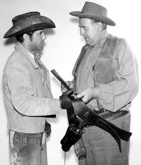 "Robert Fuller and Roy Barcroft on location for an episode of ""Laramie""."