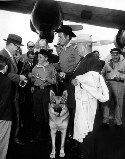 Corporal Rusty (Lee Aaker), Lt. Rip Masters (James Brown) and Rin Tin Tin receive some sort of airline award circa 1956.