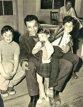 "Cameron Mitchell of ""The High Chaparral"" with three of his children."