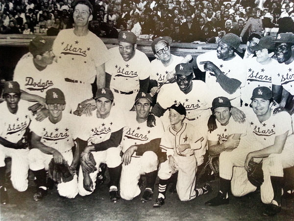 A combination of TV cowboys, singers, sports stars and actors at the 1962 Hollywood Stars baseball game at L.A. Dodger stadium. Top Row (L-R): Dean Martin, Chuck Connors, Joe Louis, Phil Silvers, Nat King Cole, Archie Moore, Pat Boone, Rafer Johnson. Bottom Row (L-R): Johnny Mathis, Peter Brown, Michael Dante, John Beradino, Jay North, Jack Warden, Max Baer Jr. (Thanx to John Bickler.)