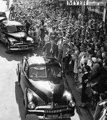 William Boyd—Hopalong Cassidy—is surrounded by fans while visiting Melbourne, Australia in 1954.