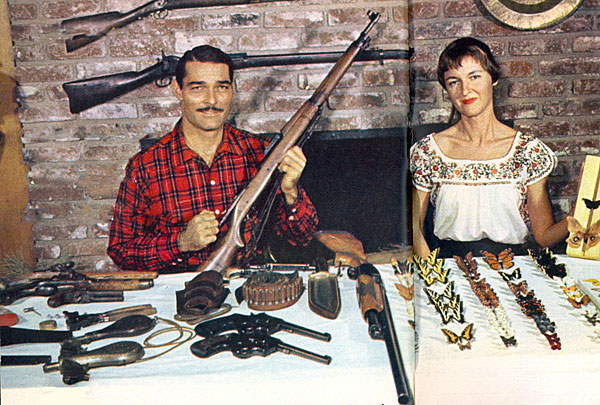 """Lawman"" John Russell, a member of the NRA, was a gun collector for about 25 years as of 1959 when this photo was taken. His wife, Renata collected butterflies. She had about 200."