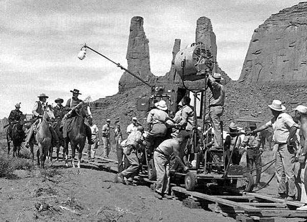 "Filming a scene for ""The Searchers"" with John Wayne in front of the Three Sisters rock formation in Monument Valley. (Thanx to Jerry Whittington.)"