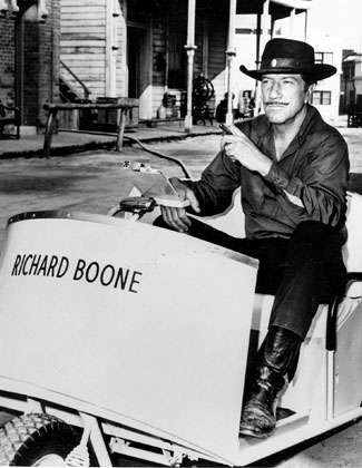 "No horsin' around for Paladin! Richard Boone gets around the ""Have Gun Will Travel"" backlot in a golf cart."
