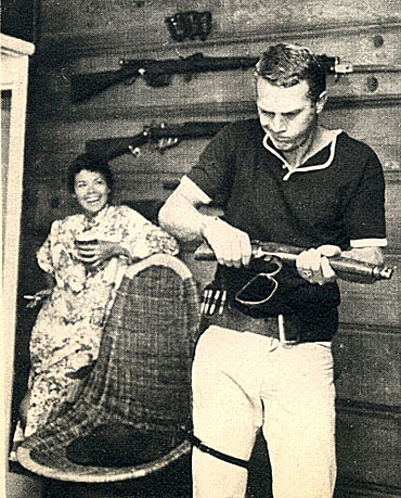 "Steve McQueen learns how to handle his Mare's Laig for his new ""Wanted Dead or Alive"" series as wife Neile Adams laughs in the background."