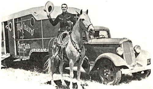 Ken Maynard takes Tarzan out of his travel van in the '30s. Tarzan's van was the forerunner of today's costly horse trailers.