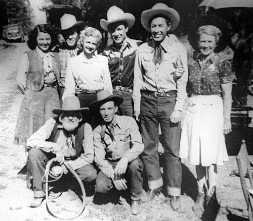 Group photo taken in the mid '40s during one of Roy Rogers' Republic Westerns. Top row L-R: riding double Mildred Jenkins, Tim Spencer, Dale Evans, Roy Rogers, Karl Farr, unknown. Kneeling: Gabby Hayes, Ken Carson. (Photo from the family of Mildred Jenkins.)