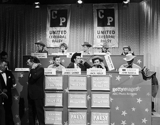 "In October 1958 seven Warner Bros. TV heroes guested on Pat Boone's TV show in New York City. Afterward all seven helped man the phones at a Cerebral Palsy Telethon. L-R top row: Will ""Sugarfoot"" Hutchins, Peter ""Lawman"" Brown, Wayde ""Colt .45"" Preston. Bottom Row L-R: Ty ""Bronco"" Hardin, James ""Maverick"" Garner, Jack ""Maverick"" Kelly, John ""Lawman"" Russell. The MC left of Hardin is Dennis James."