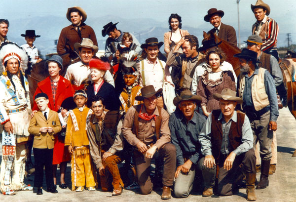 "A terrific roundup of TV Western heroes...but for what event? Anyone have any idea? Top Row (L-R) Clu Gulager (""Tall Man""), Bruce Yarnell (""Outlaws""), Robert Fuller (""Laramie""), frequent TV Western guest star Suzanne Lloyd, Richard Eastham (""Tombstone Territory""), Jack Ging (""Tales of Wells Fargo""). Middle Row (L-R) Iron Eyes Cody, Ann Doran (""Legend of Jesse James""), Sheb Wooley (""Rawhide""), Spring Byington (""Laramie""), Dennis Weaver (""Gunsmoke""), Clint Eastwood (""Rawhide""), frequent guest star Joanna Moore, Frank McGrath (""Wagon Train""), James Murdock (""Rawhide""). Front Row (Kneeling L-R) Robert Cabal (""Rawhide""), John Smith (""Laramie""), Terry Wilson (""Wagon Train""), William Demarest (""Tales of Wells Fargo""). Photo looks to have been taken at a 1962 event."