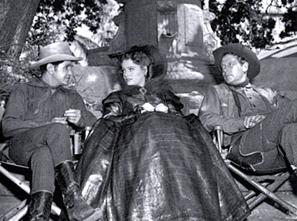 "Bob Steele, Alexis Smith and Joel McCrea take a break from filming ""South of St. Louis"" ('49 Warner Bros.)."