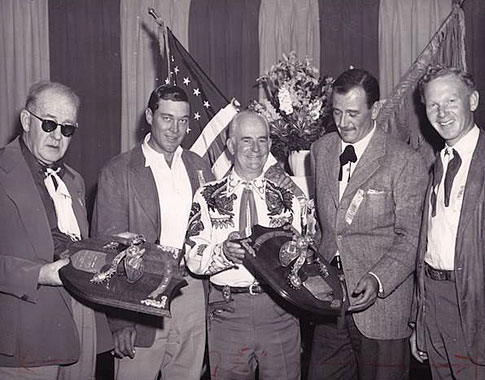John Ford and John Wayne accept Silver Spur Awards in ??. Accompanying them are Ben Johnson and Harry Carey Jr.