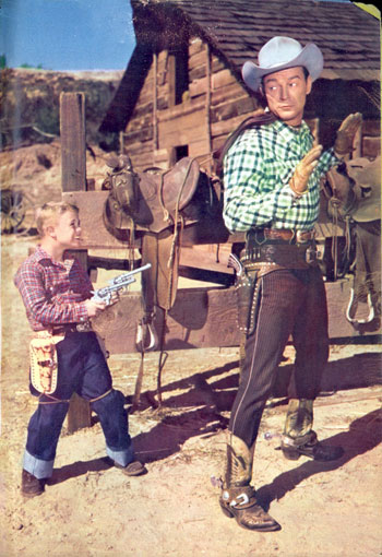 Six year old Deever Jenkins holds Roy Rogers at bay for a 1955 TV GUIDE photo shoot.