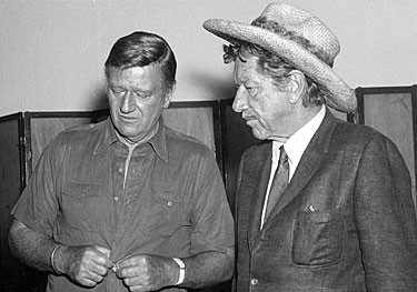 A quiet moment with John Wayne and Richard Boone.