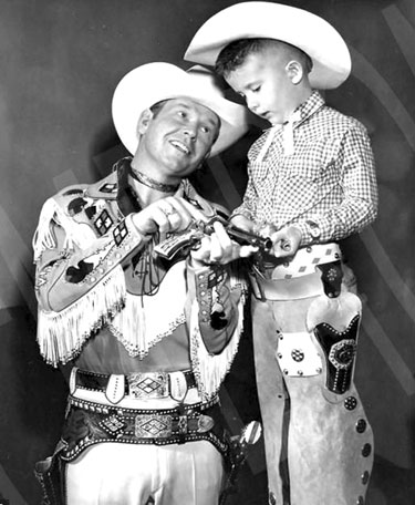 ex Allen dispenses a little six-gun instruction to a young fan.
