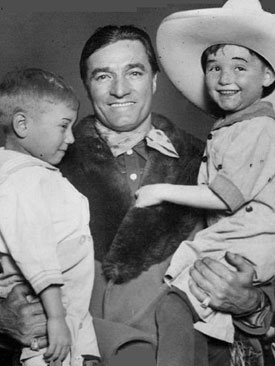 Tom Mix makes a couple of young fans very happy!