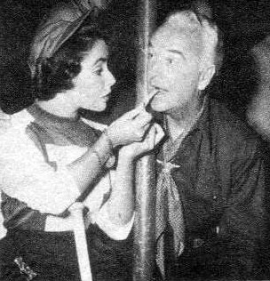 Not sure exactly what's going on in this photo, but I'm sure Hopalong Cassidy was happy to be doing anything with cute Elizabeth Taylor.