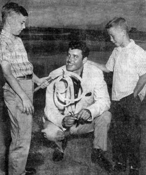 "TV's ""Zorro"", Guy Williams, was in Albuquerque, New Mexico June 19-21, 1959 appearing at the Greater New Mexico Sports Show. Dennis Crosby (left) and Rusty Strong presented Williams with an authentic bullwhip."