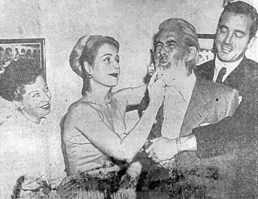 """Ouch! Careful with that comb!"" Gabby Hayes exclaims as Mary Beth Hughes primps while John Payne holds on and Helen Forrest watches. The foursome were in San Antonio, TX for the premiere of ""El Paso"" at the Majestic Theatre."