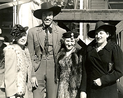 Cesar Romero as the Cisco Kid with three devoted fans in 1940.