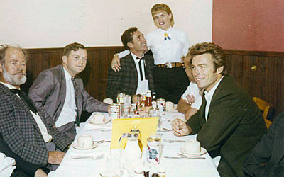 While appearing at a rodeo in Sikeston, MO, Paul Brinegar, Sheb Wooley and Clint Eastwood enjoy a bite to eat at the War Drum restaurant in the Gay 90s Village in Sikeston.