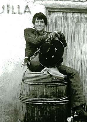 "Manolito, Henry Darrow, relaxes on the set of ""High Chaparral"". (Thanx to Ginny Shook.)"