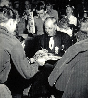 A later in life Hoot Gibson signs autographs at an event somehow involving Roy Rogers and Quaker Oats. (Photo from LONE PINE IN THE MOVIES.)