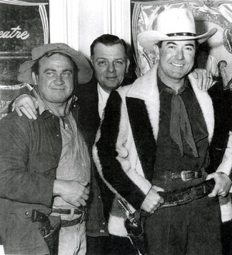 "Dub ""Cannonball"" Taylor and Johnny Mack Brown, wearing a Hudson Bay coat, are ready for a movie theatre appearance with the local owner. (Photo courtesy Cynthia Hale.)"