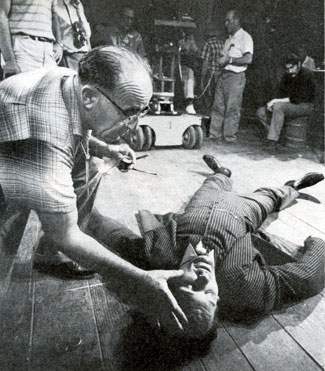 "To simulate bruises a make-up man daubs makeup on the face of Robert Rockwell for an episode of TV's ""Man From Blackhawk"" after Bob is knocked out in a brawl."