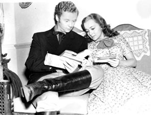 "Tim Holt and Olivia de Havilland look over their fan mail while filming ""Gold Is Where You Find it"" ('38 Warner Bros.)."