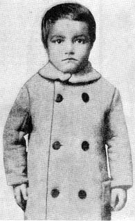 Guess who? He became one of the screen's biggest cowboy stars. In this photo he was 3 and a half years old. (Answer at bottom of this column.)