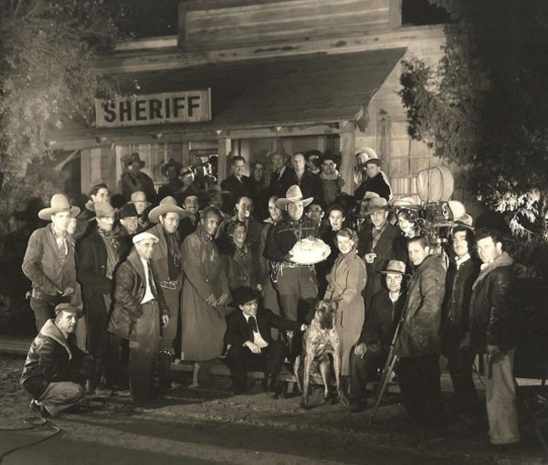"Buck Jones celebrates a birthday with the cast and crew of ""Left-Handed Law"" ('37 Universal). (Thanx to Tinsley Yarbrough.)"
