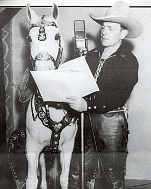 "Buck Jones shares a script of his 1937 radio series ""Hoofbeats"" with his great horse Silver."