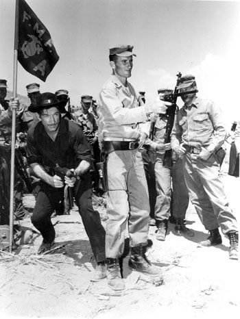 Have Machine Gun Will Travel. Richard Boone trades in his six-gun for a publicity shot with the U.S. Marines.