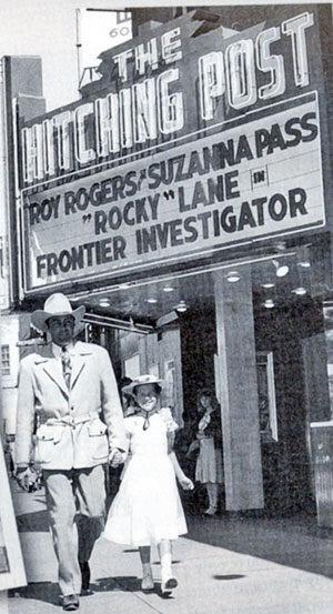 "Allan ""Rocky"" Lane escorts a young fan to a showing of his ""Frontier Investigator"" in 1949 at the famous Hitching Post theater in L.A. (Note the misspelling of 'Susanna'  on the marquee.)"