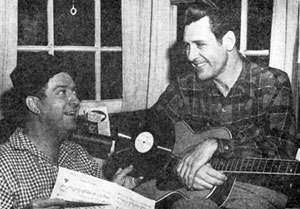 Singer/actor Doye O'Dell talks over his new record with Smiley Burnette in 1947.
