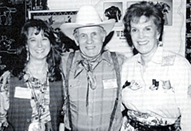 Stuntman and artist Walt LaRue happily finds himself surrounded by Susan Deland (left), the former Gene Autry Museum's director of merchandise operations, and the late Joanne Hale, Monte's widow, who was the Autry Museum's executive director.