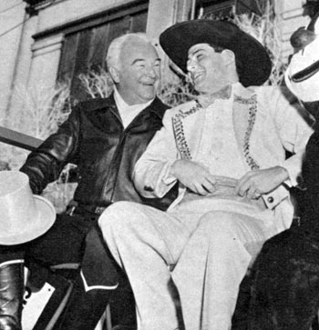 Hopalong Cassidy and singer Eddie Fisher swapped hats while riding in Macy's annual Christmas parade in 1953.