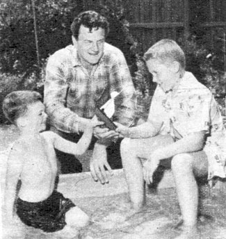 """Gunsmoke"" star James Arness at home with his young sons Rolf and Craig. Circa Summer '57."